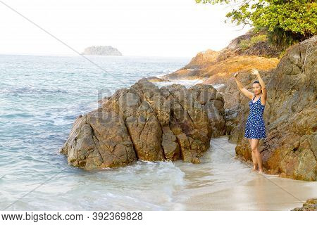 Woman Stand Relax In Morning On Lonely Beach At Beach Koh Chang Thailand. Koh Chang Is Located In Th