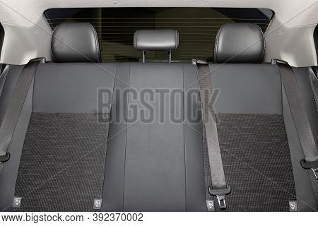 Rear Car Interior Including Gray Car Rear Seat And Rear Window And Safety Belt Or Seat Belt
