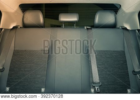 Rear Car Interior Including Gray Car Rear Seat And Rear Window And Safety Belt Or Seat Belt In Vinta