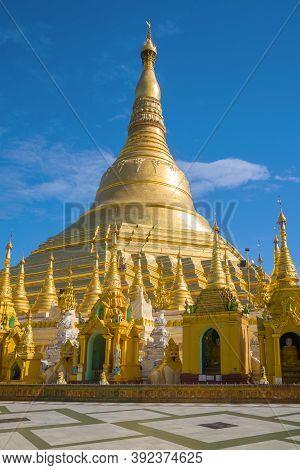 Sacred Shwedagon Stupa Against The Blue Sky. Yangon, Myanmar