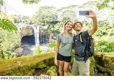 A Couple At The Rainbow Falls, Hilo, Wailuku River State Park, Big Island, Hawaii