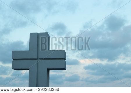 Religious Christian Cross Against The Sky With Copy Space. Faith And Religion Concept Illustration.