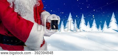 Santa Is Holding Up A Jewelry Case With A Ring In A Wintery Landscape