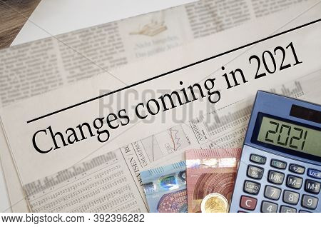 Newspaper With Money And Calculator And Headline Changes Coming In 2021
