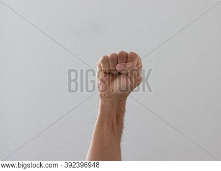 Hand With Clenched A Fist, Isolated On A White Background.