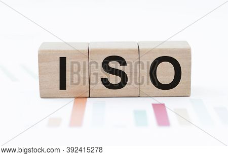 Iso Word Written On Wood Block. Faqs Text On Table, Concept.