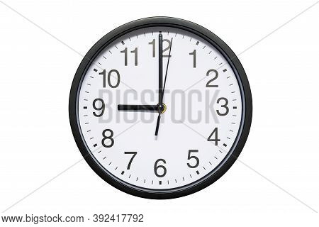 Wall Clock Shows Time 9 O'clock On White Isolated Background. Round Wall Clock - Front View. Twenty