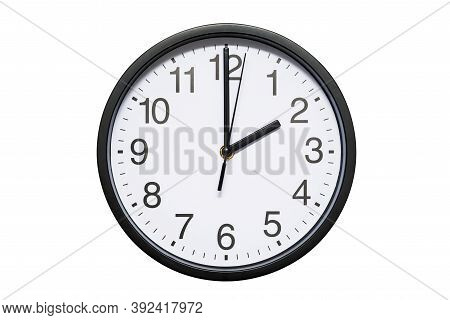 Wall Clock Shows Time 2 O'clock On White Isolated Background. Round Wall Clock - Front View. Fourtee