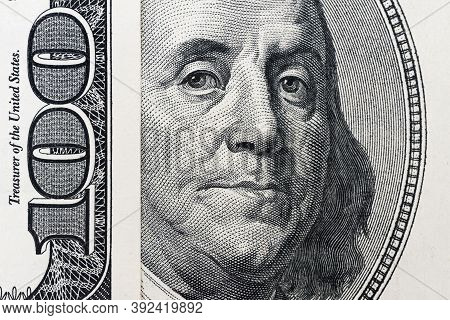 Benjamin Franklin's Eyes From A Hundred-dollar Bill. The Eyes Of Benjamin Franklin On The Hundred Do