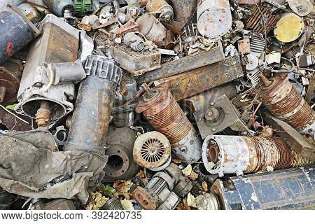 Rusty Engines Stacked In The Scrapyard. Engine Parts Greased And Covered With Rust. Dump Of Pieces O