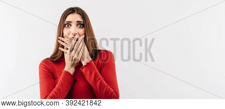 I Am Afraid. Image Of Young Scared Woman With Long Chestnut Hair In Casual Red Sweater Covering Her