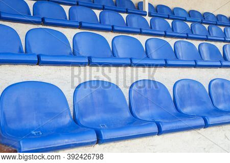 Blue Rows Of Seats In A Sports Hall. Stadium Seating. Empty Rows Of Chairs, Seats In The Concert Hal