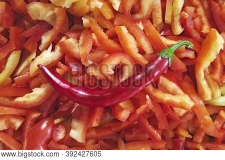 Red Chili Pepper On The Background Of Chopped Sweet Pepper