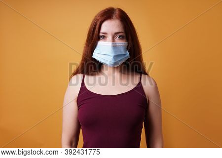 Young Woman Wearing A Medical Face Mask Covering Mouth And Nose - Protection Against Corona Virus -