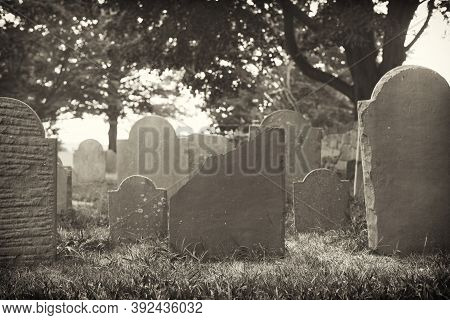 Old And Weathered Headstones In The Oldest Cemetery In Salem Massachusetts The Burying Point Under A