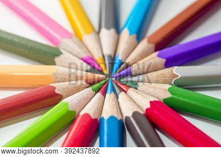 Many Different Colored Pencils On White Background. Color Pencils In Arrange In Color Wheel Colors O