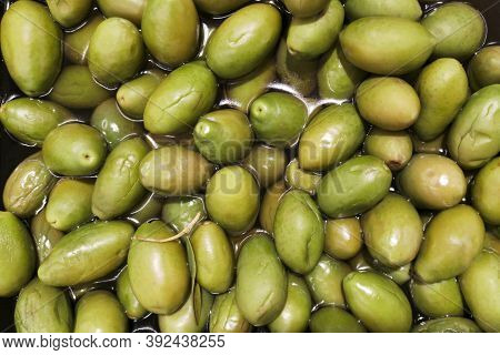 Stall Of Olives At The Market. Variety Of Olives For Sale At An Open-air Market. Green Olives