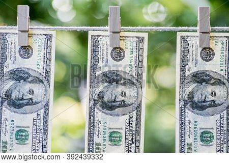 Money Laundering. Money Laundering Us Dollars Hung Out To Dry. 100 Dollar Bills Hanging On Clothesli