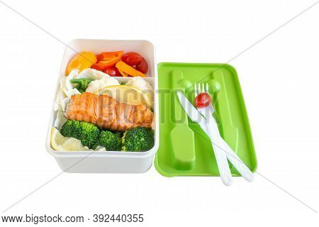 Grilled Salmon With Tomato Salsa And Salad, Cooked At Home In A Lunch Box On A White Background. The