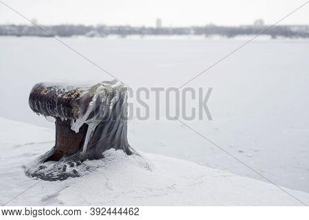 Mooring Post In Winter. Wharf In Winter, Bollard