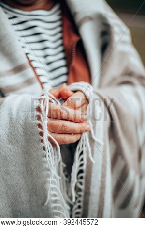 Female Hands In A Warm Knitted Blanket To Keep Warm In Cold October Weather And Standing In The Fore