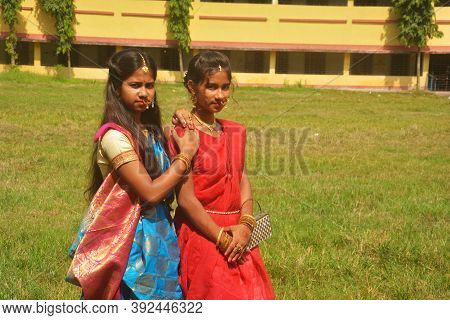 Close Up Of Two Sisters Wearing Traditional Saree And Jewelleries Like Nose Rings Earrings Maang Tik