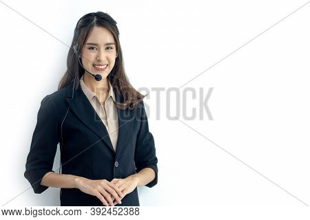 Photo Of Beautiful Young Asian Call Center Operator Standing Isolated On White Background. Woman Wit