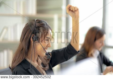 Smiling Beautiful Woman With Headset Working In Call Center As A Customer Service Agent Celebrating