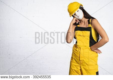 Construction Worker Outfit Compliant With Health And Safety Regulations. Juvenile Worker At The Cons