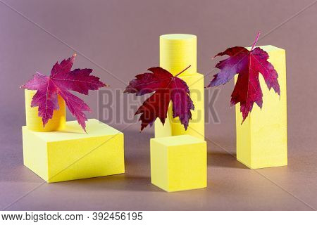 Abstract Minimal Stage With Yellow Geometric Platforms And Red Maple Leaves. Abstract Autumn Backgro