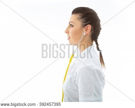 Brunette Doctor In White Wearing And Stethoscope