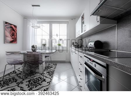 Kitchen Currently At Home With Classical Style, Decorated In White With Marble Fittings And Big Brig