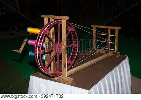 Old Wooden Spinning Wheel Traditional Tools Of Seamstresses In Thailand.
