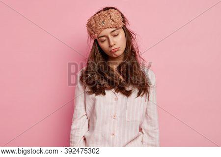 Tired Sleepy Woman Wears Eyemask And Nightwear, Wants To Sleep, Displeased To Wake Up Very Early, Po