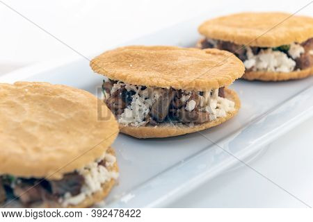 Three Gorditas Served With On A Long Plate Looks And Tastes Appealing.