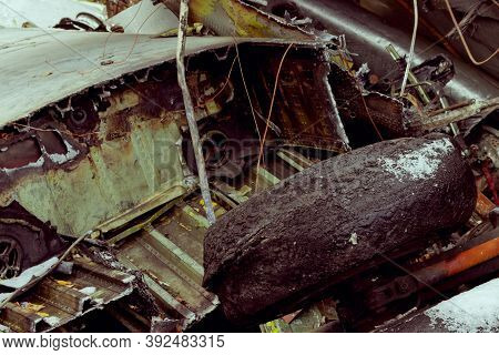 Plane Wreckage, Parts Of The Fuselage And Wing Of The Burned And Broken Aircraft At The Landfill Of