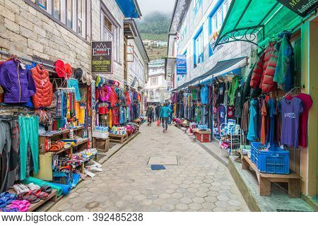 Namche Bazaar, Nepal : October-14-2018 :  The Clothing And Souvenir Shops In The Main Street Of Namc