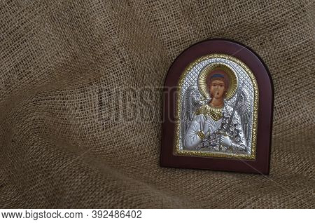 Christian Icon Of The Archangel Michael With Silver And Gilding. The Inscription In Russian Is Trans