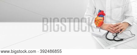 Cardiology Concept, Diagnostic, And Medical Care Cardiovascular System. Doctor Sitting In His Medica
