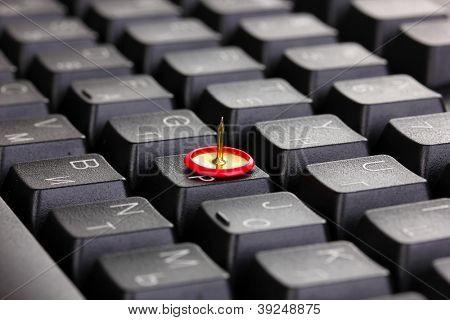 Painful typing, pin on keyboard close-up