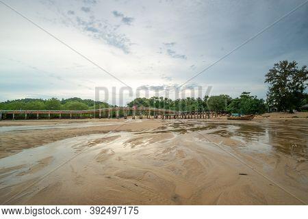 Ranong, Thailand - September 20, 2020 : A Beautiful View Of Tropical Beach With Bridge At Koh Phayam