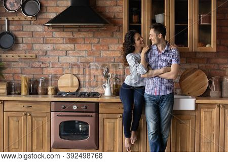 Happy Couple Renters Relax In New Renovated Home Kitchen