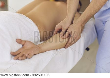 Chiropractor Hands Doing Treatment Of Acupressure For Mans Hand