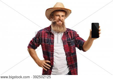 Young bearded farmer showing a smartphone isolated on white background