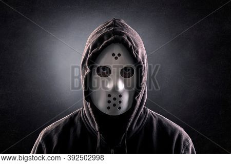 Hooded maniac or criminal in mask