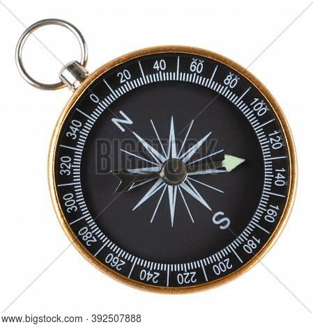 Black Compass In A Gold Metal Case, Macro Photography, On A White Background, Frontal Arrangement