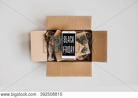 Black Friday Sale, Deals Concept. Packing Box, Gifts And Cell Phone With Text Black Friday Flat Lay