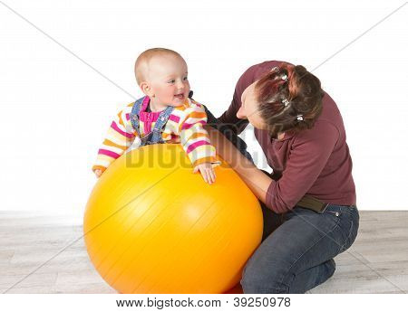 Devoted Mother Exercising Her Baby