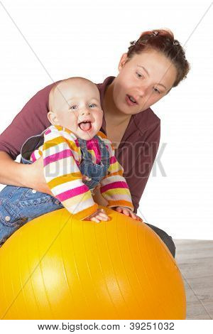 Laughing Baby Doing Exercises