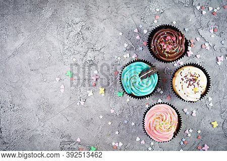 Tasty Colorful Cupcakes Isolated On Grey Background. Delicious Cupcake